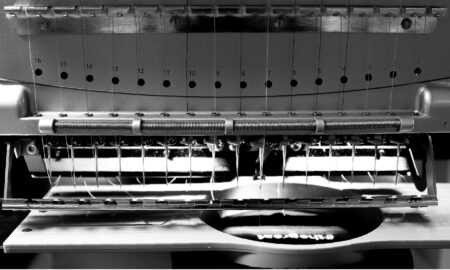 Black and White image of Melco Embroidery Machine with Mighty Hoop
