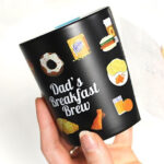 Black Mug with personalised dad's breakfast crew design made with Forever Transfers Multi-Trans Paper