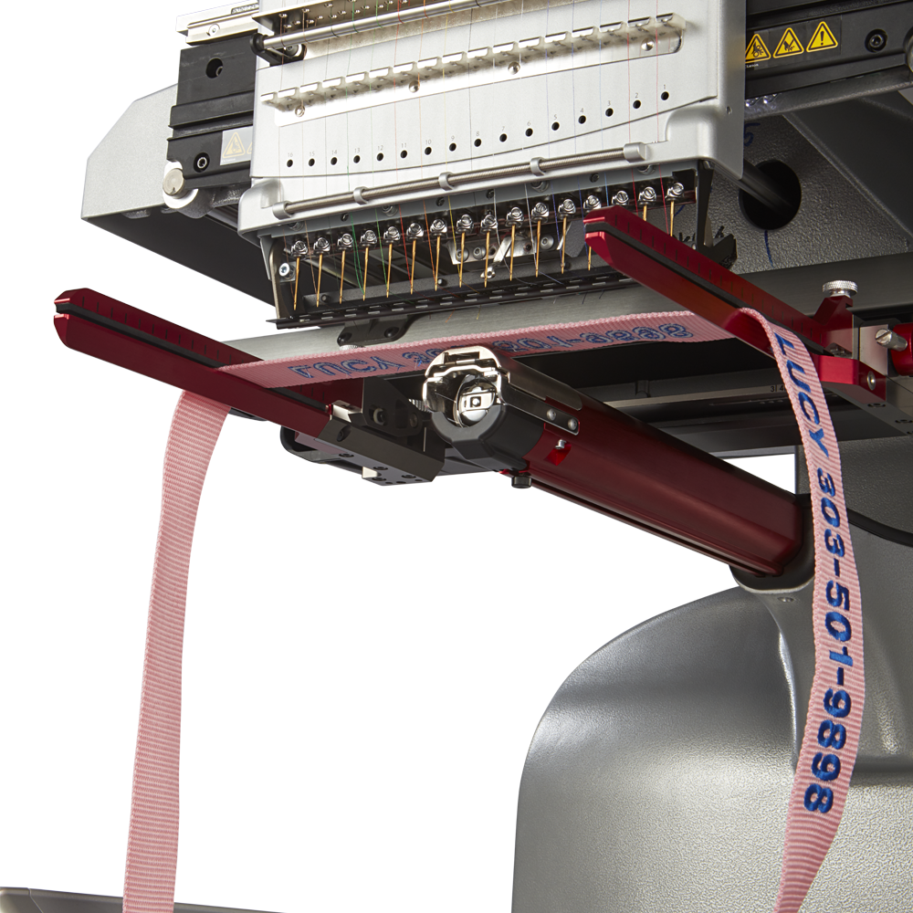 Melco EMT16X Embroidery Machine embroidering on a dog collar with white background