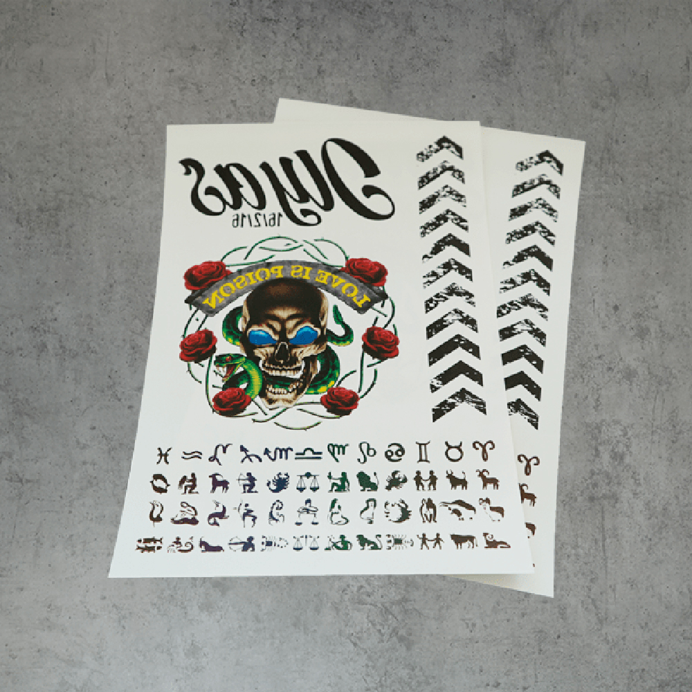 Tattoo prints on sheet of Forever Transfers A4 Laser Tattoo Paper with B Paper