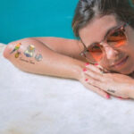 Woman by pool with tatoos using Forever A4 Laser Tattoo Transfer Paper