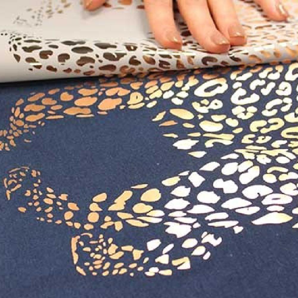 Leopard design being transferred onto black shirt using Forever Flex Soft (No Cut) Metallic Paper