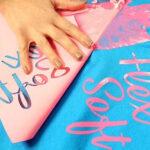Pink design being transferred onto blue shirt using Forever Flex Soft (No Cut) Paper