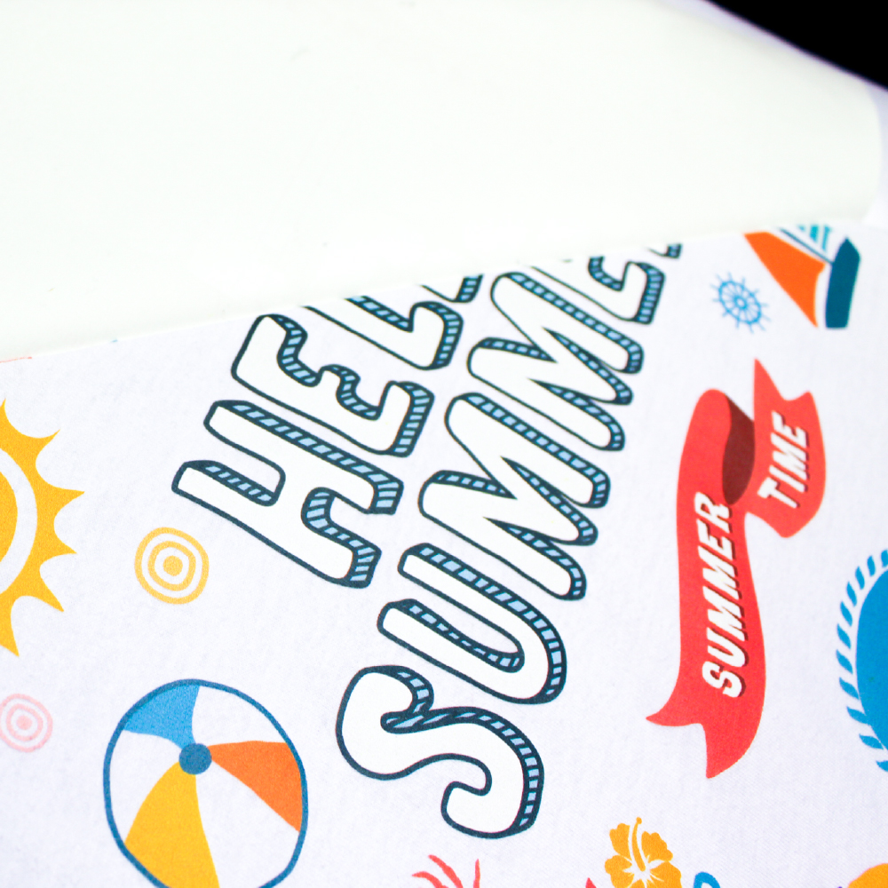 Hello Summer print being transferred onto a white shirt using Forever Laser Light No Cut Paper