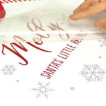 Christmas theme shirt being transferred using Sef Glitterflex Paper