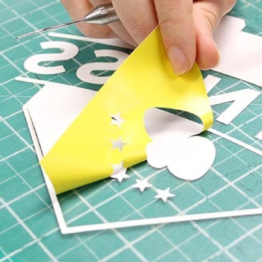 Design being weeded using Maxxflex Subliblock II Vinyl