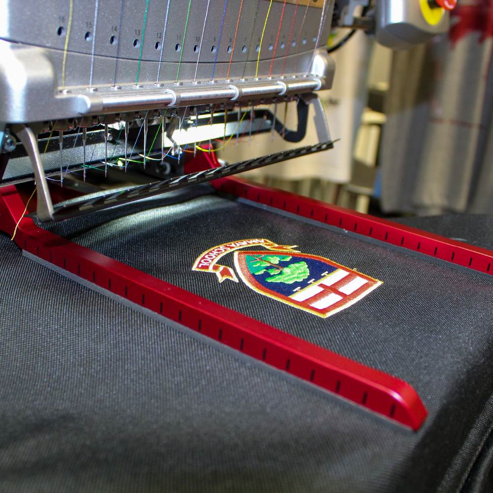 Melco Fast Clamp Pro on Melco EMT16X Embroidery Machine with school bag