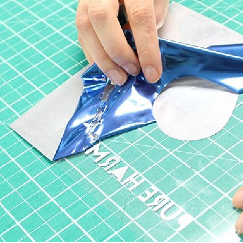 Pure harmony logo being weeded using Sef Metalflex Vinyl
