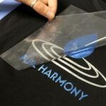 Pure harmony logo being transferred onto black shirt using Sef Metalflex Vinyl