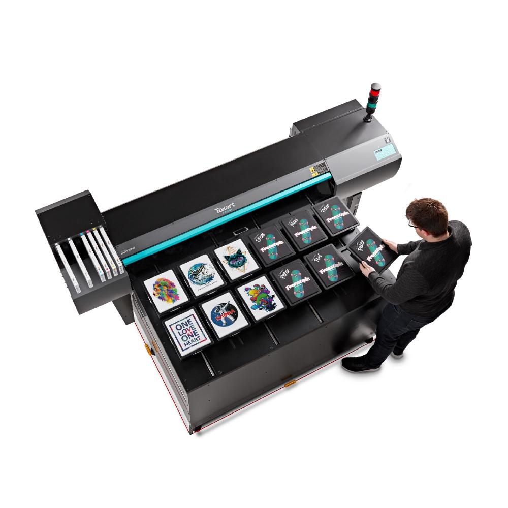 Man using a Roland XT-640S Direct to Garment Printer