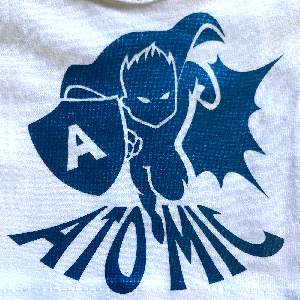 White fabric with super hero design made with Sef Flex Cut Atomic Blue Vinyl
