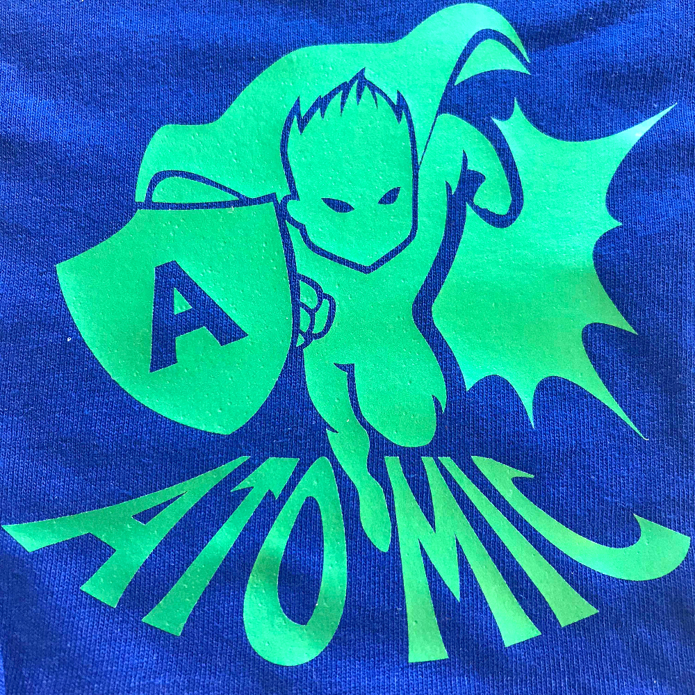 Blue fabric with super hero design made with Sef Flex Cut Atomic Green Vinyl