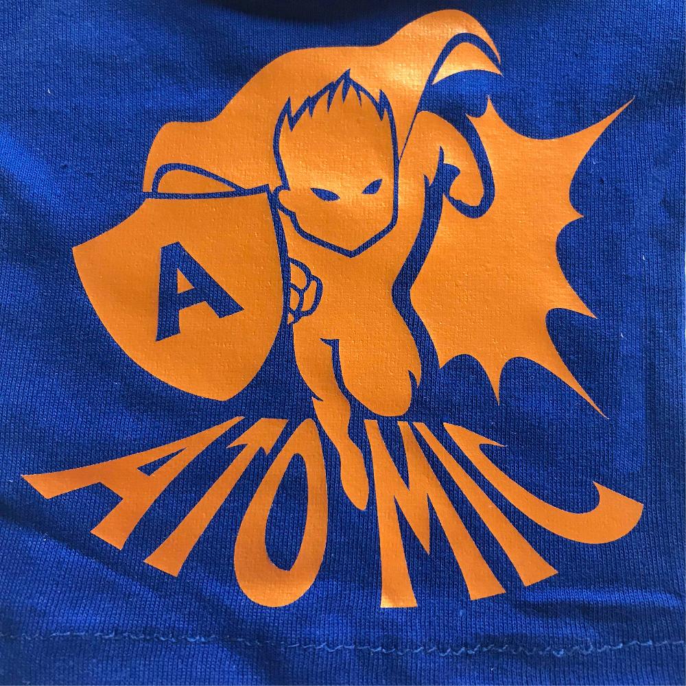 Blue fabric with super hero design made with Sef Flex Cut Atomic Orange Vinyl