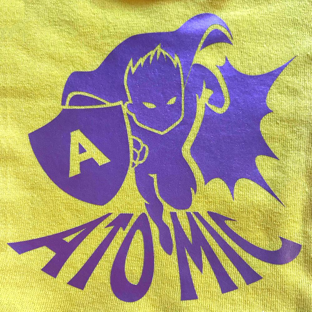 Yellow fabric with super hero design made with Sef Flex Cut Atomic Purple Vinyl