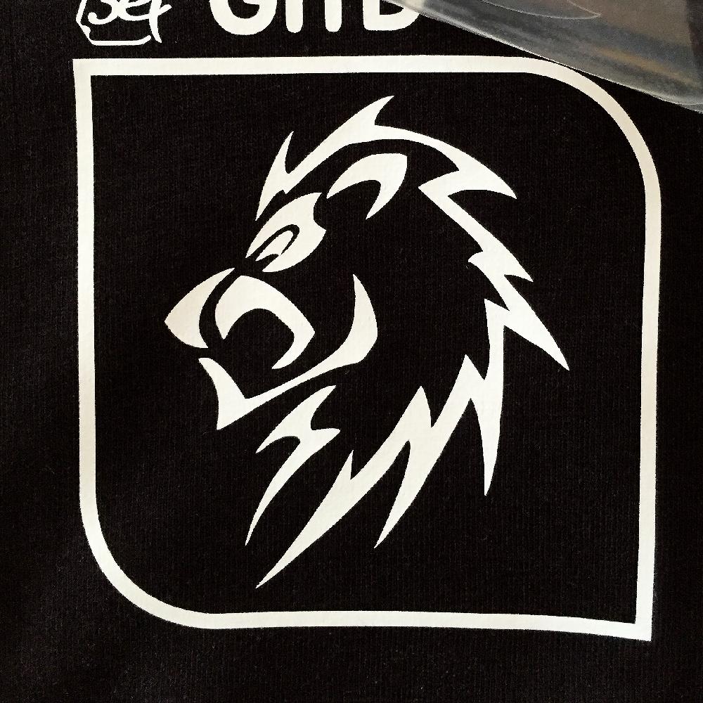 White Lion Logo design on shirt made with Sef Flex Cut Sticky Glow In The Dark Vinyl