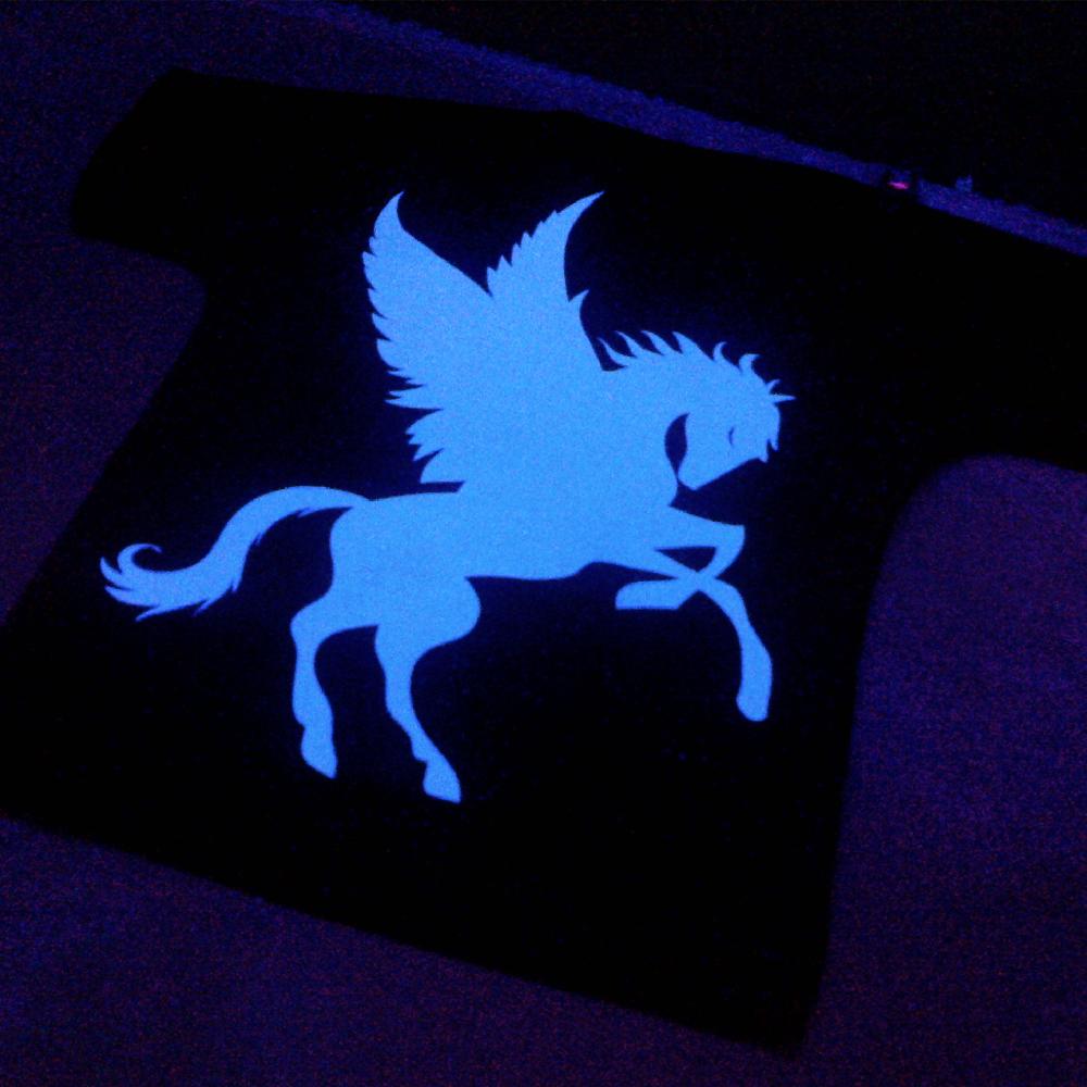 T-Shirt under UV Lamp showing glow in the dark designs made with Sef Flex Cut Sticky Night Club Vinyl
