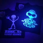 T-Shirts under UV Lamp showing glow in the dark designs made with Sef Flex Cut Sticky Night Club Vinyl