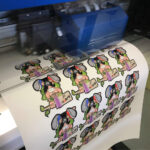 Sheet of monkey prints on Roland SG2 Series print and cut machine with Sef MoZaic 500mm wide Vinyl