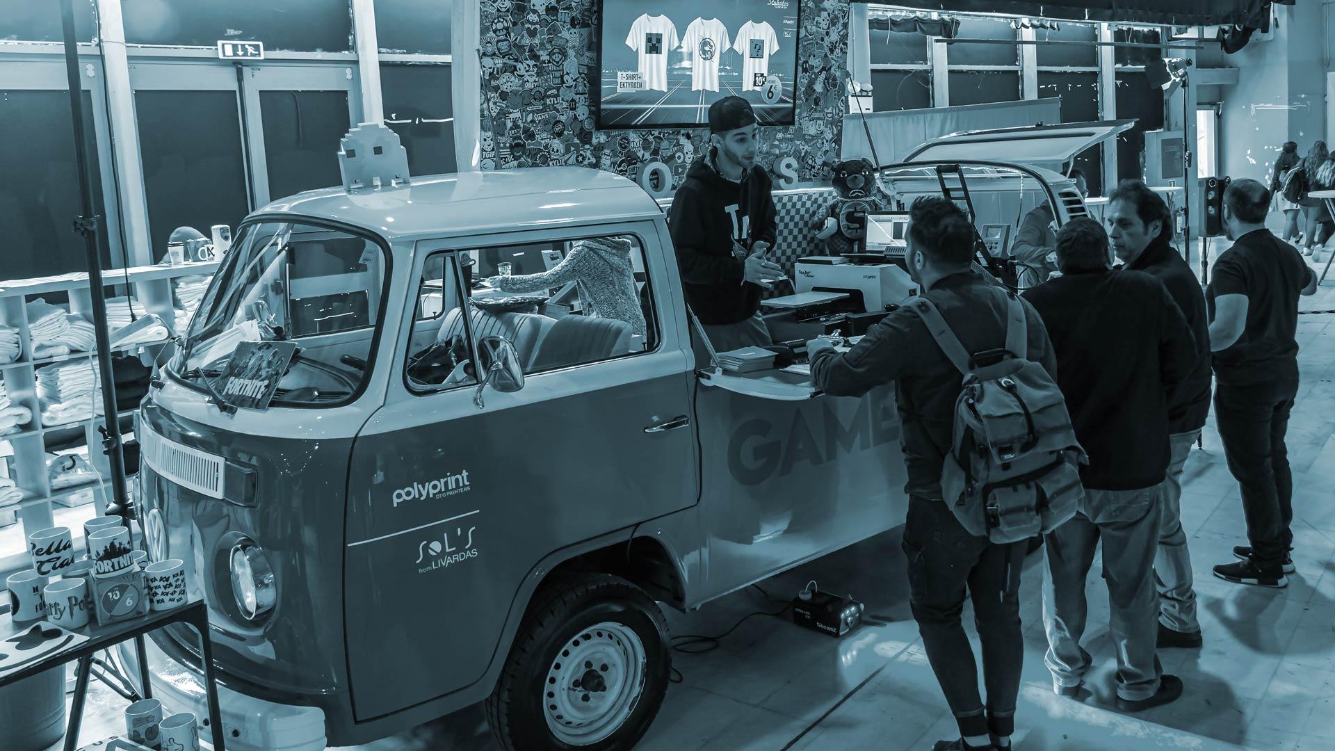 Blue tinted image of Texjet Shortee2 Printer on mini-van at event