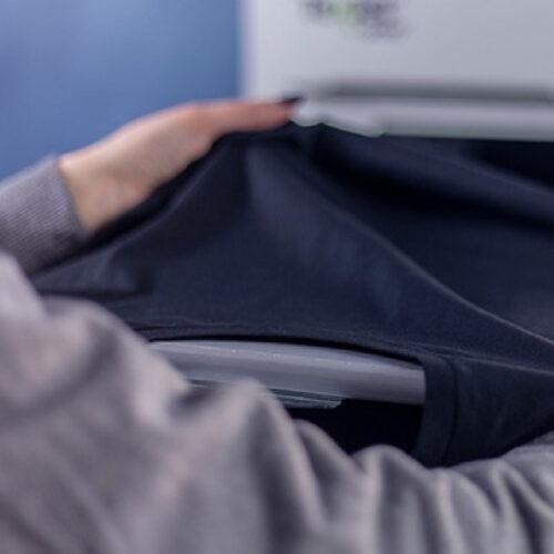 Placing shirt on platen on Texjet Polyprint Echo2 Direct to garment Printer