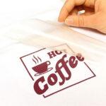 Red coffee design being transferred using Sef Maxxflex Vinyl