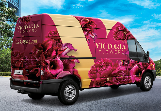 Van outside with Victoria flowers branding wrap, made with Roland True Vis SG2 Series Printers