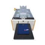 Chiossi Speedy T Folding Machine with folded blue garment