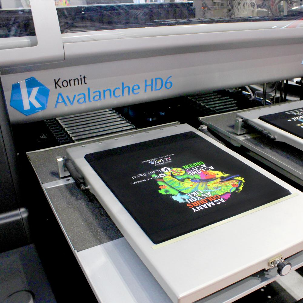Kornit Avalanche HD6 printer with black garment design featuring gecko