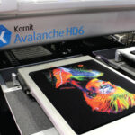 Kornit Avalanche HD6 printer with black garment design featuring colourful woman