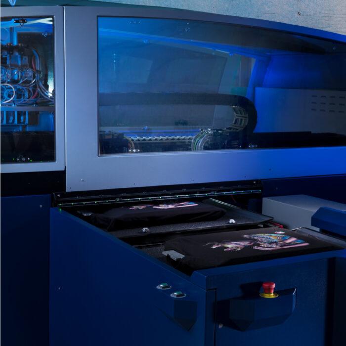 Kornit Vulcan Plus Machine with two printed garments