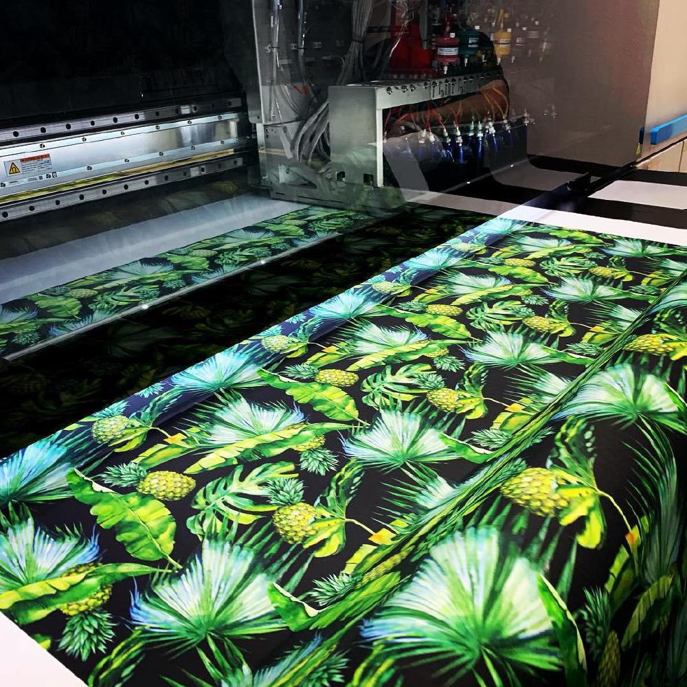 Large palm design being printed onto fabric using Kornit Presto