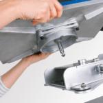 Hands placing Stahls Hotronix Power Platen onto press
