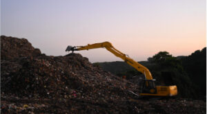 Digger on landfill site