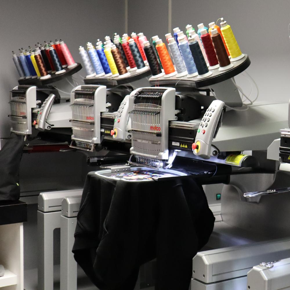 Melco Embroidery Machine with garments in Amaya Sales UK Showroom