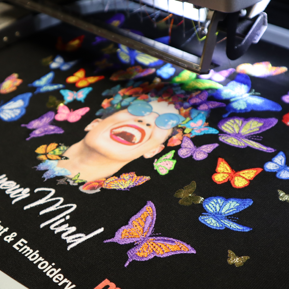 Melco Embroidery Machine with Mighty Hoop and butterfly design