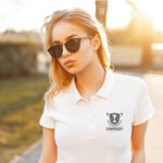 Woman in sunglasses outside with championship logo on T-shirt printed with Five Star Universal Paper