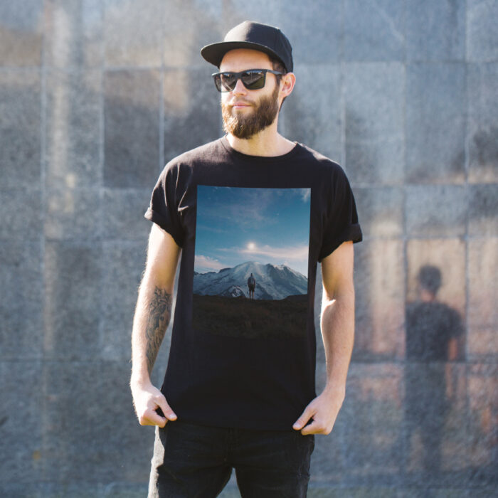 Man outside in black t-shirt with block image print of mountains printed with Forever Laser Dark Cuttable Paper