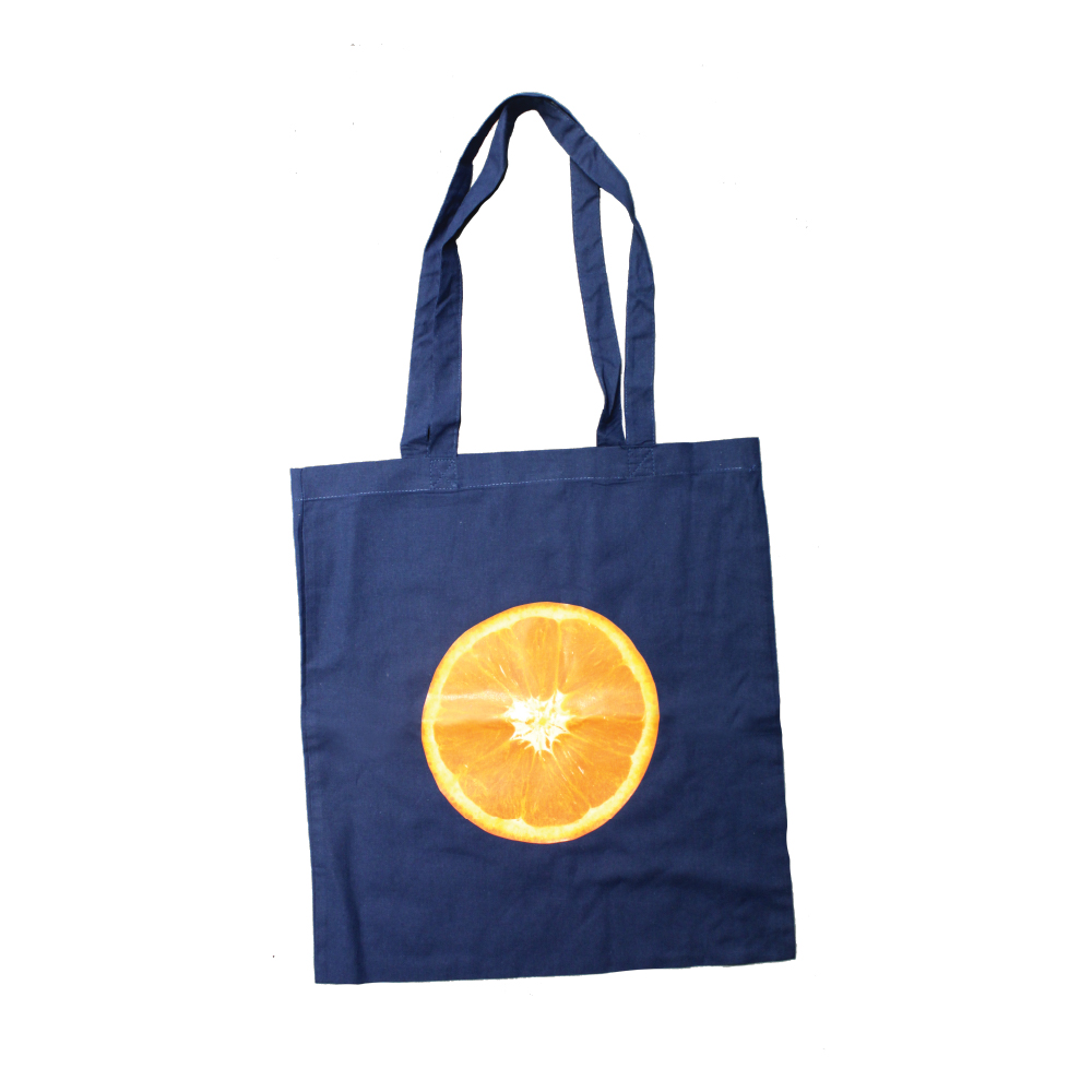 Navy Blue Tote Bag with print of Orange Slice printed using Forever Laser Dark Cuttable Paper on white background