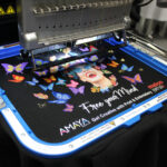 Melco EMT16X Embroidery Machine with 11×13″ Mighty Hoop embroidering on a garment