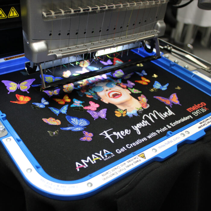 """Melco EMT16X Embroidery Machine with 11x13"""" Mighty Hoop embroidering on a garment"""