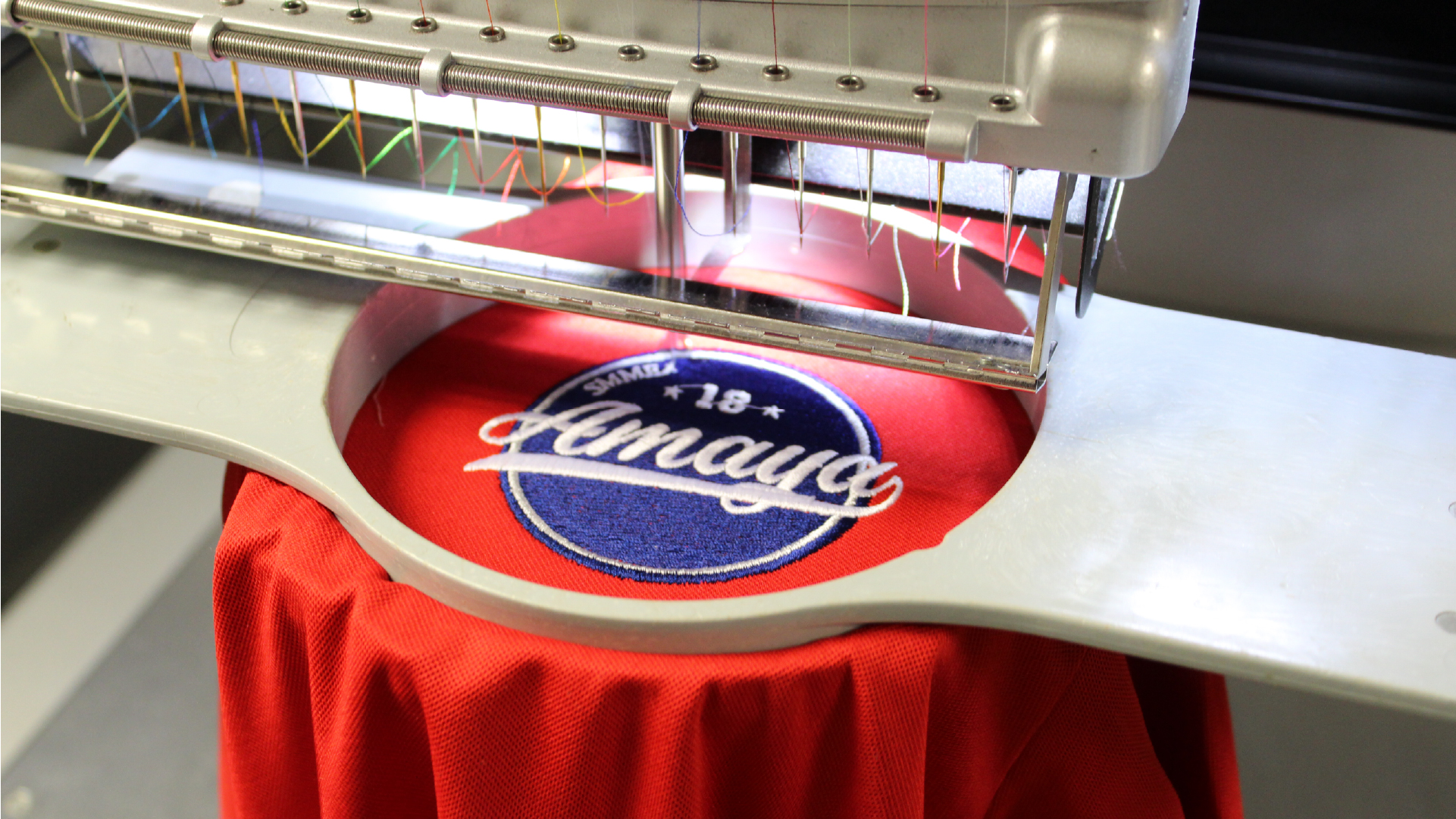 garment in a mighty hoop on a melco emt16x modular embroidery machine