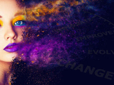 Lady with bright rainbow makeup with distortion effect on dark background