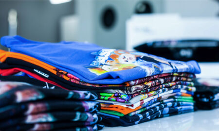 stack of t-shirts printed with texjet direct to garment printers