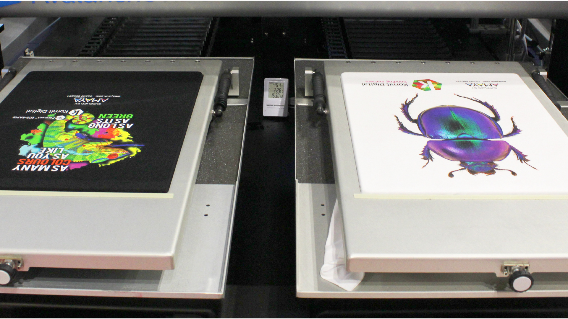 Two printing pallets on a kornit digital direct to garment printer